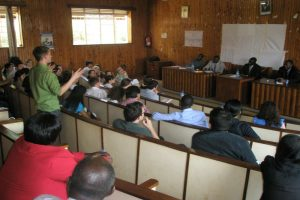 Research students in a panel discussion with subject specialists in Uganda