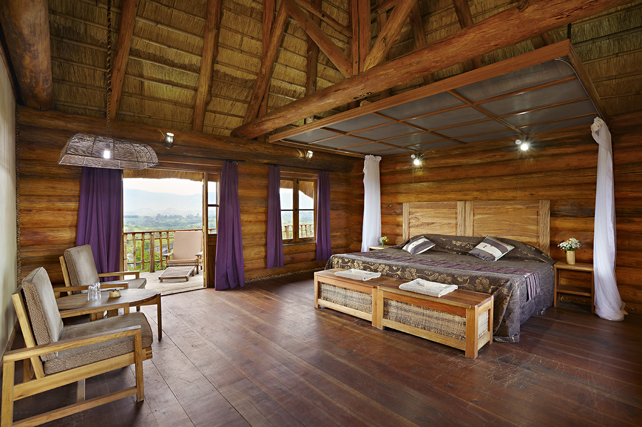 Kyaninga Lodge Bedroom with scenic view of neighbouring villages
