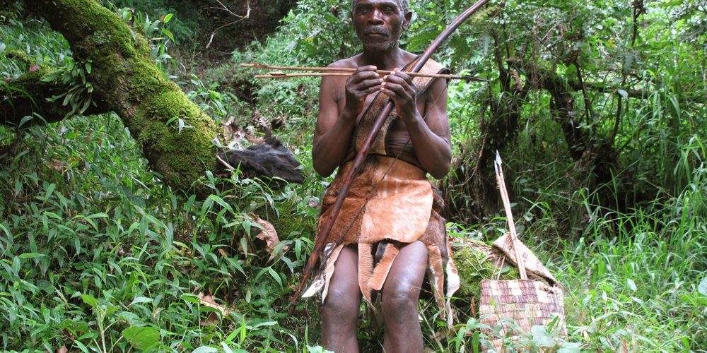 Batwa hunter in the forest.