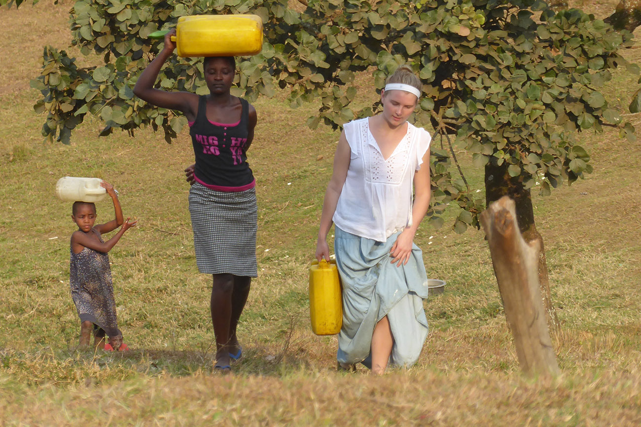 Fetching water during a homestay in Uganda.