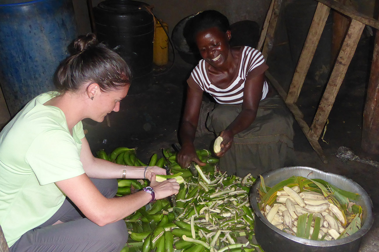 Peeling Matoke at a homestay in Uganda.