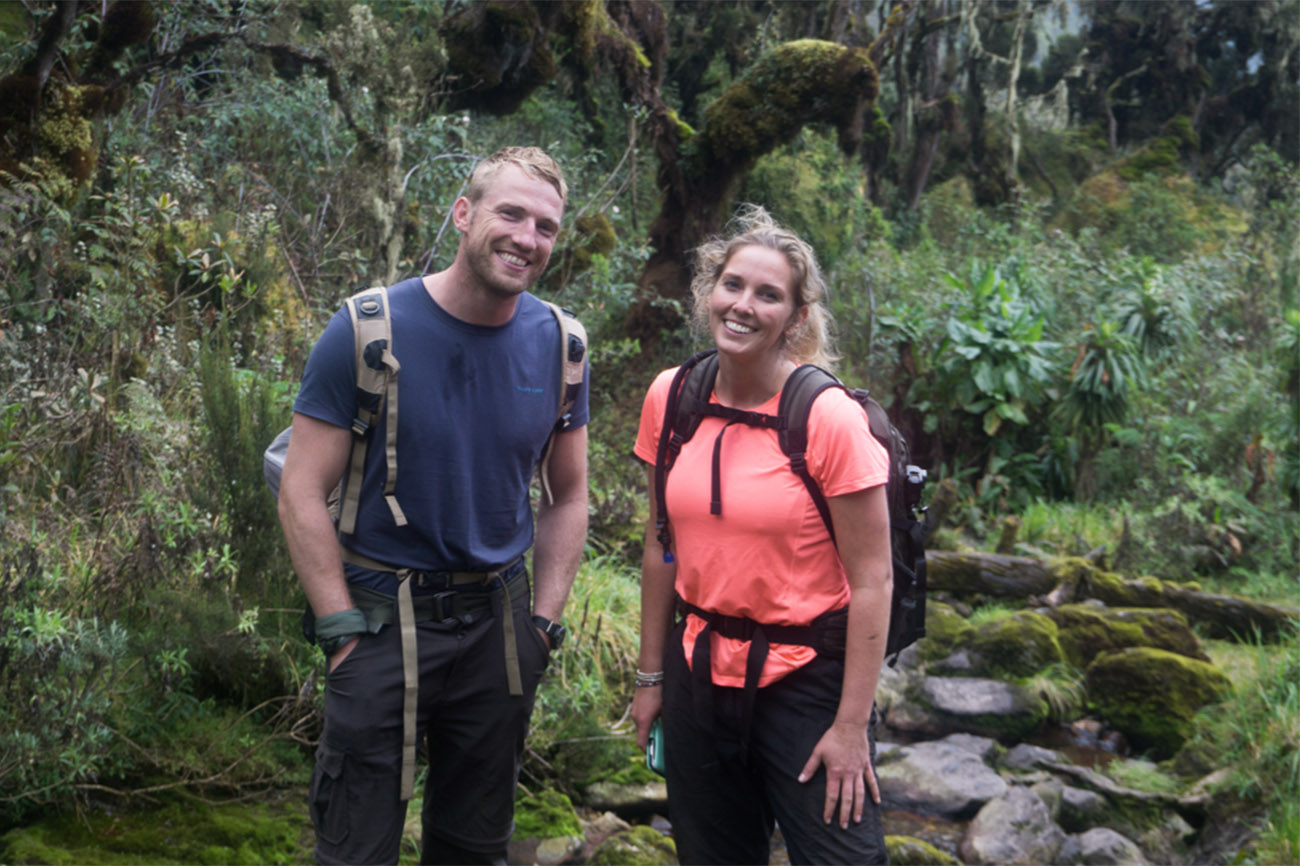 Day one: setting off from the Rwenzori National Park entrance on the walk up through the dense forest. A multitude of birds species and even some Colobus monkeys on the way to Sine Camp. Enock's Falls is the perfect spot for an evening shower.