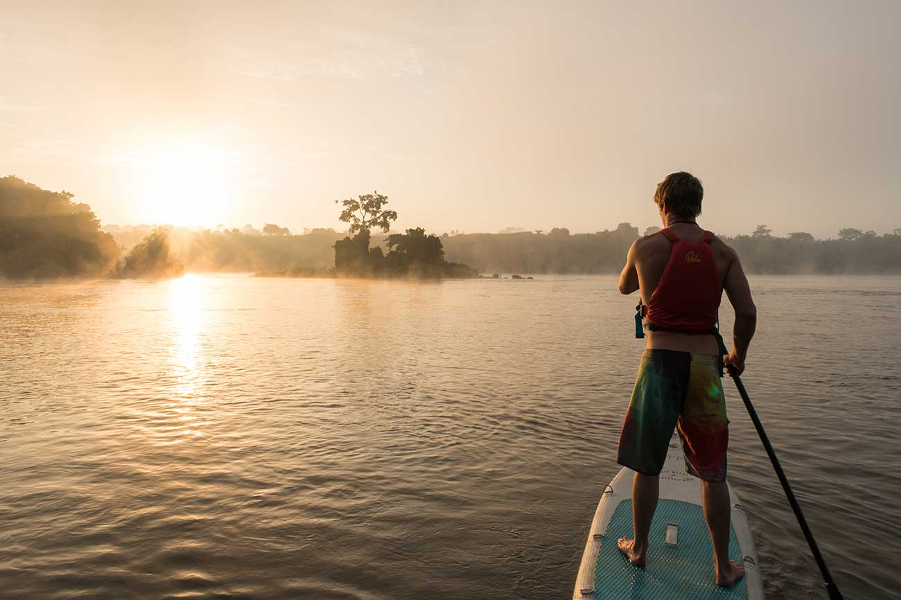 Stand Up Paddle boarding at sunset on the Nile in Uganda